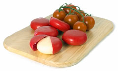 red Babybel cheeses and cherry tomatoes