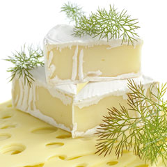 brie cheese with fresh dill garnish