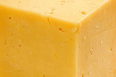 block of yellow cheddar cheese