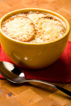 gruyere cheese and croutons in French onion soup