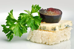 roquefort cheese canape with grape and parsley garnish